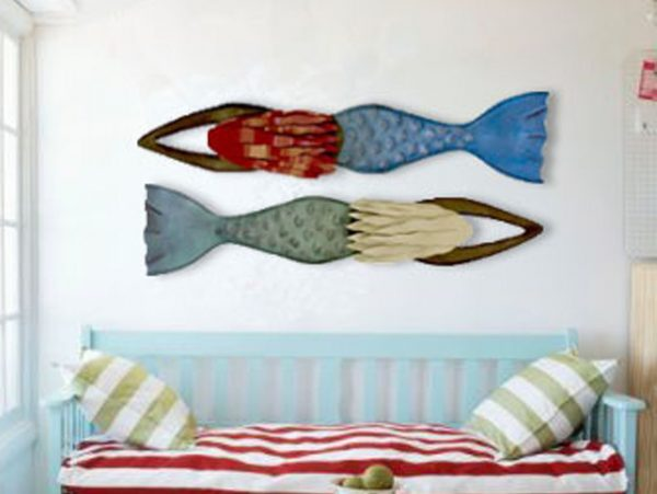 Two Mermaid Sculptures above bed