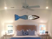 large-blue-mermaid-sculpture-over-bed-in-coastal-walter-bedroom-web