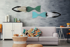 Modern coastal living room with sofa and furniture with hand forged metal mermaid sculptures by Chase Allen