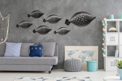 Grey home interior with nautical wall decor sofa carpet and white storage unit