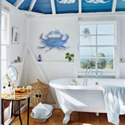 bathroom with crab sculpture