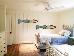 2 Mermaid Sculptures in coastal bedroom